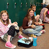 Third graders enjoy their lunches among empty lockers on the last day of school.  The school cafeteria closed down a day early.<br /> <br /> Photo by Chris Rourke