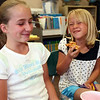 Amber Guerrieri and Kali Wiggin enjoy pizza and a good laugh on the last day of 3rd grade in Mrs. Wells class.<br /> <br /> Photo by Chris Rourke