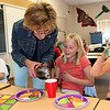 Mrs. Wells serves Katie Nicholl more soda during a pizza party on the last day of school.<br /> <br /> Photo by Chris Rourke