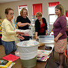 The kindergarten teachers go through materials to be packed on the last day of school.  Kindergarten classes will be at the newly remodeled Lake School next fall.<br /> <br /> Photo by Chris Rourke