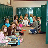 Third graderes at GES enjoy their lunch among empty lockers on the last day of school.  The school cafeteria closed a day early.<br /> <br /> Photo by Chris Rourke