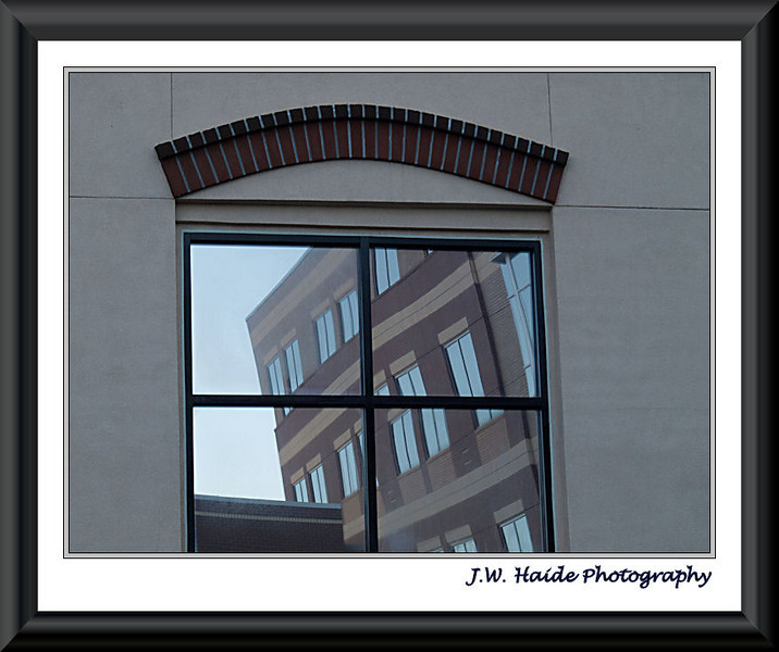 Reflection in window of building next to Hillsboro Civic Center