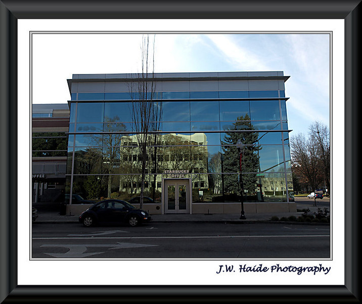 Justice Center building reflected in Hillsboro City Civic center building. My reflection is in right hand door.