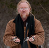 """<div class=""""jaDesc""""> <h4>Jerry Feeding Chickadees - Amherst Island - February 7, 2011 - Video Attached</h4> <p> This was my turn at holding black-oiled sunflower seeds in my hands. I had as many as 4 Chickadees on my hands at once. See the attached video clip.  After lugging my camera, big lens and tripod through the deep snow for 30 minutes, I looked rather bedraggled.</p> </div> <center> <a href=""""http://www.youtube.com/watch?v=PgsxgPXwgwQ""""  style=""""color: #0000FF"""" class=""""lightbox""""><strong> Play Video</strong></a>"""