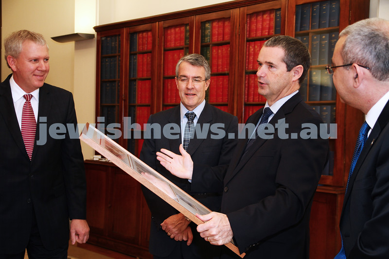 10-5-13. Launch of Israel-Australia stamp at Treasury Place, Melbourne. Minister Stephen Conroy holding framed stamps. Photo: AJN/Peter Haskin