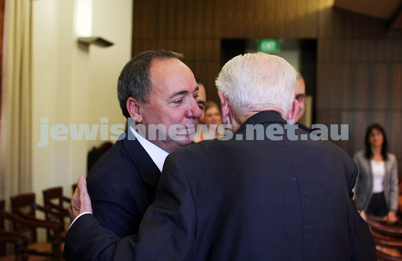 10-5-13. Launch of Israel-Australia stamp at Treasury Place, Melbourne. Israeli ambassador Yuval Rotem embraces Max Stern .. Photo:Peter Haskin
