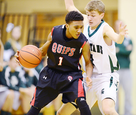 Laurel's Zachary Wilson puts pressure on an Aliquippa player.