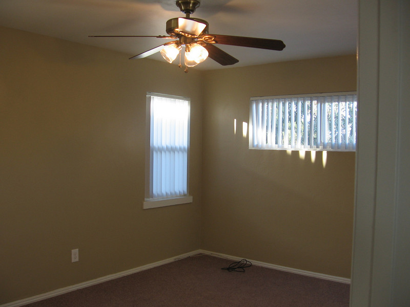 Master bedroom with ceiling fan and lights