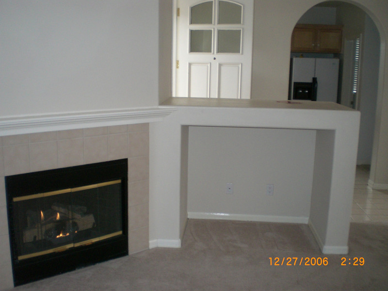 Living room with fireplace and TV insert area.