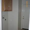 Inside laundry room with custom molding on cabinets.<br />  Entry door leads to garage with double locks for added security.