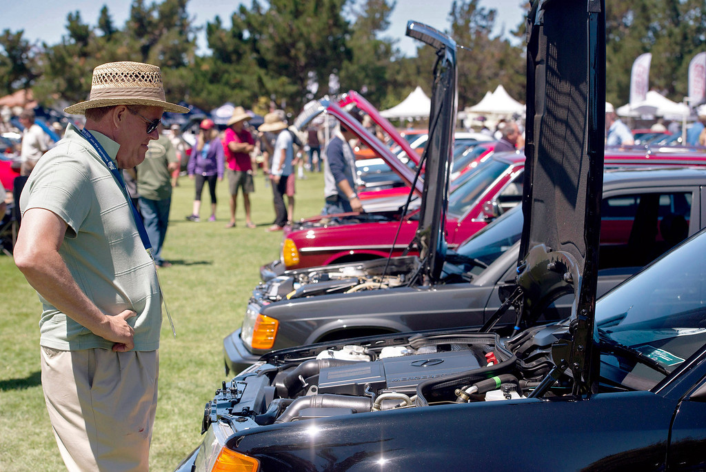 . Jan Gullett inspects a line of Class 6 Mercedes Benzs during the Legends of the Autobahn car show at Rancho Canada Golf Course Friday, August 16th, 2013. (Matthew Hintz/Monterey County Herald)