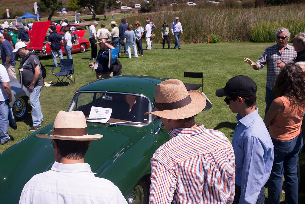 . Spectators watch the judging of a 1967 Porsche 911S Targa at Rancho Canada Golf Course during the Legends of the Autobahn car show Friday, August 16th, 2013. (Matthew Hintz/Monterey County Herald)