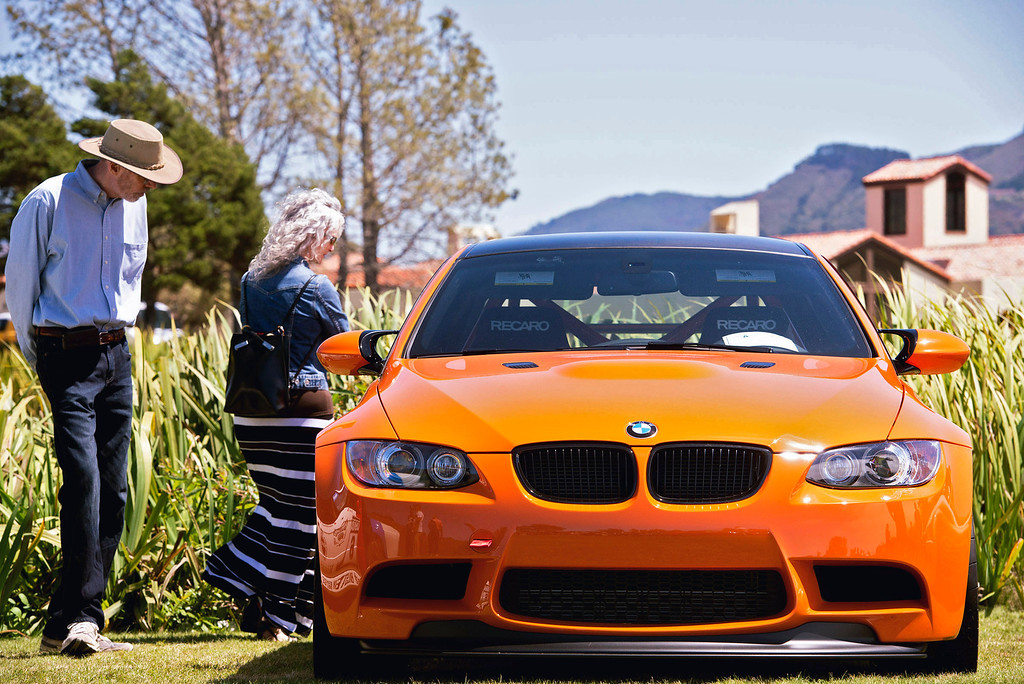 . A couple looks over a BMW on display at the Rancho Canda Golf Course, Friday, August 16th, 2013 during the Legends of the Autobahn car show. (Matthew Hintz/Monterey County Herald)