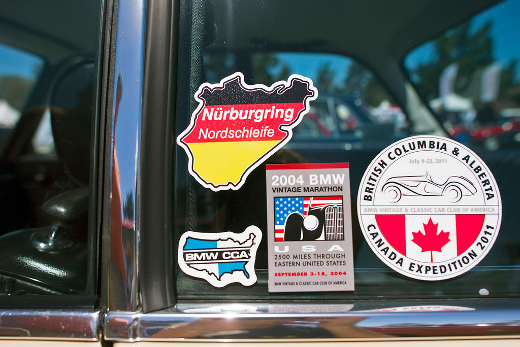 . Racing stickers adorn the window of Lou Ann Shirk\'s 1972 BMW 2002 Tii during the Legends of the Autobahn car show at Rancho Canada Golf Course Friday, August 16th, 2013. (Matthew Hintz/Monterey County Herald)