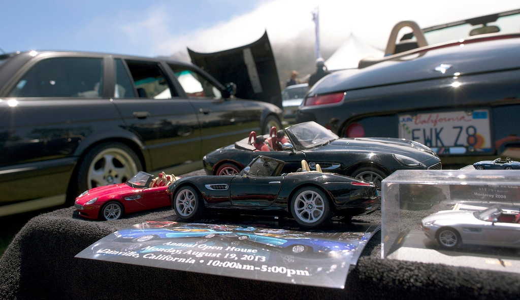 . Model cars sit in front of the lifesize counterparts at Rancho Canada Golf Course during the Legends of the Autobahn car show Friday, August 16th, 2013. (Matthew Hintz/Monterey County Herald)