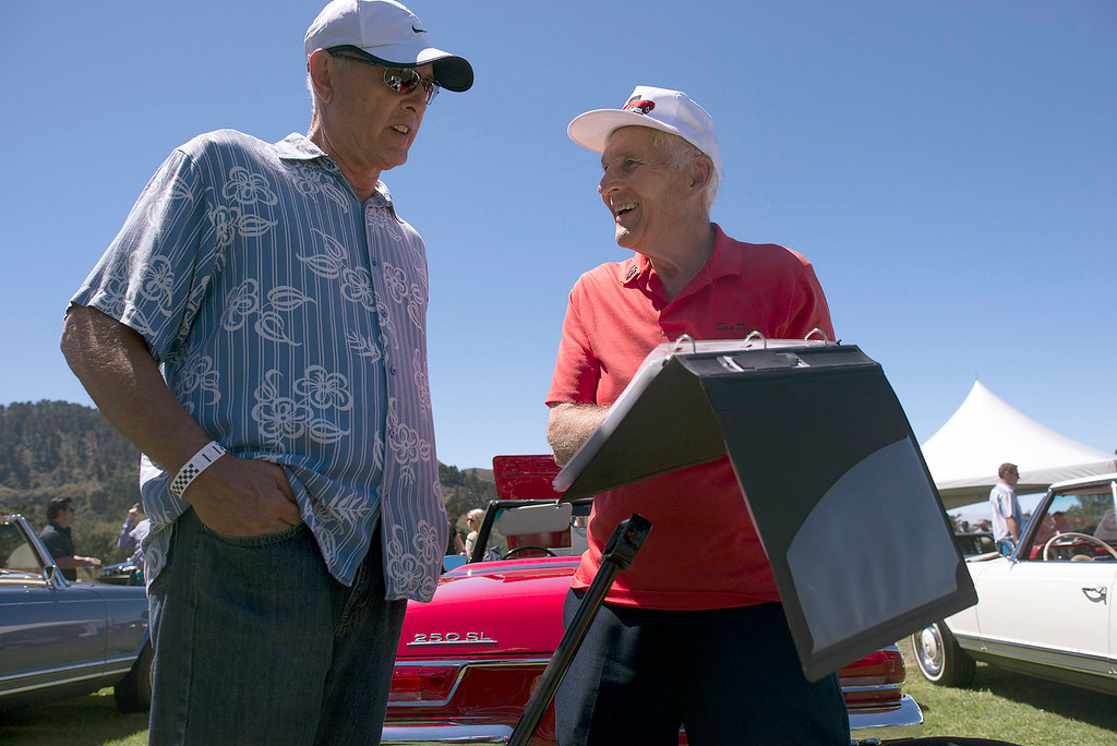 . Byron Horter talks with owner, Gary Jarvis, about his red 1967 Mercedes Benz 250 SL, Friday, August 16th, 2013 during the Legends of the Autobahn car show at Rancho Canada Golf Course. (Matthew Hintz/Monterey County Herald)
