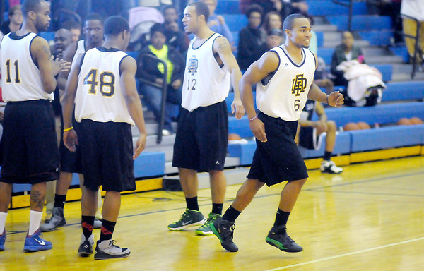 Don Knight / The Herald Bulletin<br /> Troy Taylor runs onto the court as the Anderson Legends are introduced before playing their first game at Eastside Elementary on Saturday.