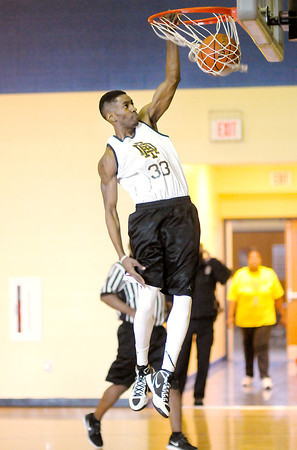 Don Knight / The Herald Bulletin<br /> The Anderson Legends' Jeremy Dupree dunks as the Legends played their first game at Eastside Elementary on Saturday.