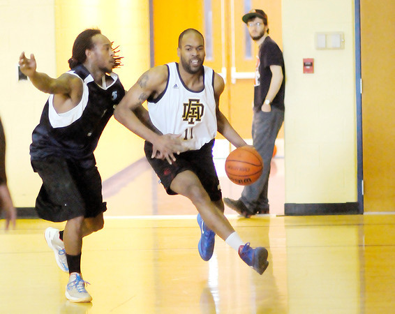 Don Knight / The Herald Bulletin<br /> The Anderson Legends' Dejovann Sawyer Davis drives to the basket as he is guarded by the Indianapolis Kings' Brandon Brown at Eastside Elementary on Saturday.