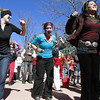 FRom left, Ilsa Tucker, Kari Smith and Denise Lynch dance in the One Billion Rising flash mob at the Capitol on Thursday.  The event was on e of hundreds across the world in more than 100 counties, part of a movement to end violence against women and girls.