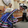 From left, Morgan Lucero,11, Josh Najarro,11, and Taylor Roybal,11, with Baile Ilusion Folklorico of Pojoaque, perform during Hispanic Cultural Day on the House Floor at the Capitol on Tuesday.  Jane Phillips/The New Mexican