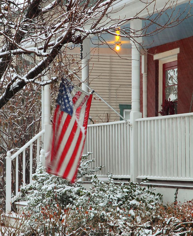 Front porch flag in a snowstorm, Lemont, PA