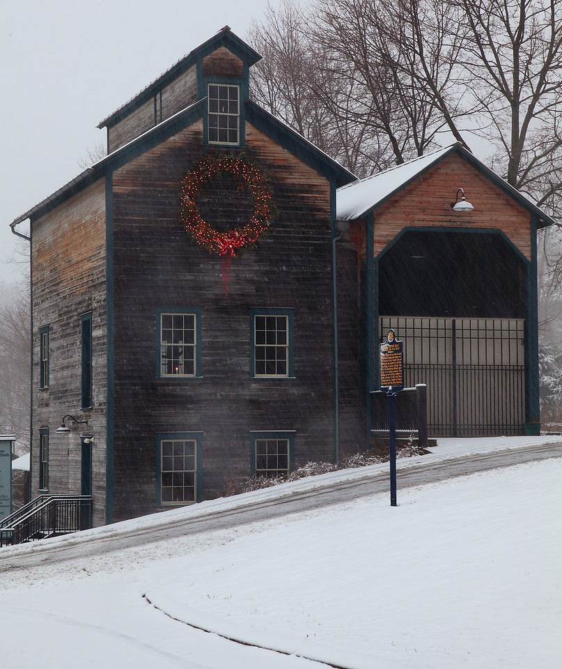 The Lemont Granary, in daylight during heavy snow.