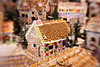 A classic gingerbread house in the middle of a candy village. Special lens effect is intentional to emphasize the dreamy nature of the display.