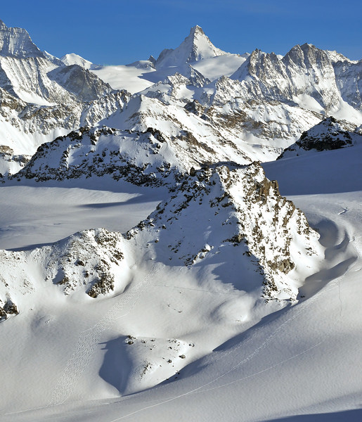 Nendaz, Mont Fort<br />  Wilderness skiing from helicopters on the rosablanche. The large peak in the background is the Dent d'Herens on the left the matterhorn