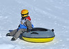 Nendaz Tracouet<br /> a young child on a rubber ring on the snow<br /> jeu d'enfants a Tracouet