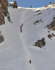 Nendaz Mont Fort<br /> skiers and snowboarders climb a couloir  on a high mountain<br /> grimper un couloir