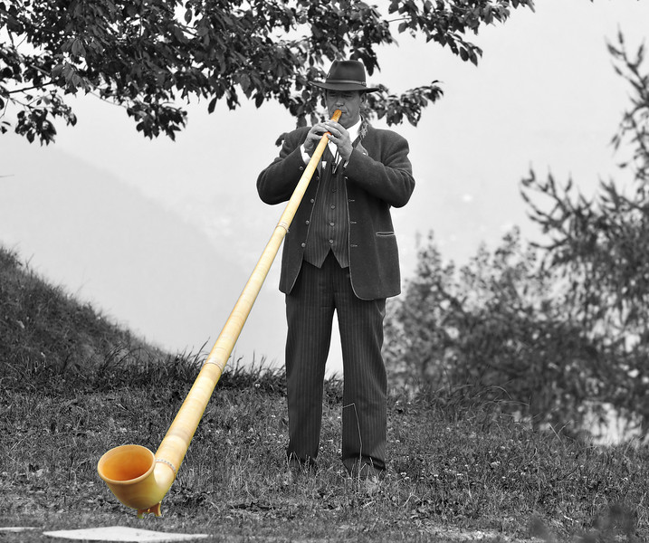 Nendaz  : monochrome of alpine horn player with horn<br /> Festival Cors des alpes