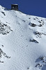 Nendaz Mont Fort<br /> Cable car station and steep glacier off-trail ski run on the Mont Fort in Verbier Switzerland<br /> Hors piste sous le Mt Fort