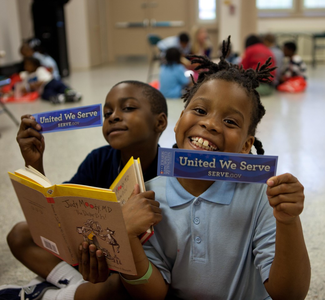 "A pair of second graders from Garfield Elementary School in Washington, DC, show off the new books and bookmarks they received during the Let's Read. Let's Move. event at their school on May 29, 2013."" alt=""A pair of second graders from Garfield Elementary School in Washington, DC, show off the new books and bookmarks they received during the Let's Read. Let's Move. event at their school on May 29, 2013. (Corporation for National and Community Service Photo)"