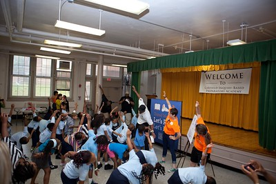 National Football League player Visanthe Shiancoe stretches with students for Let's Read. Let's Move. Corporation for National and Community Service Photo.
