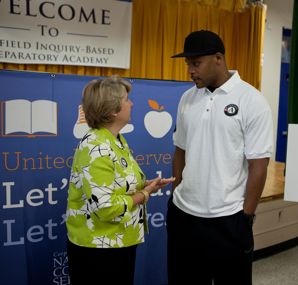 CNCS, CEO Wendy Spencer speaking with National Football League player Visanthe Shiancoe at Garfield Elementary in Washington, D.C. for Let's Read. Let's Move.Corporation for National and Community Service Photo.