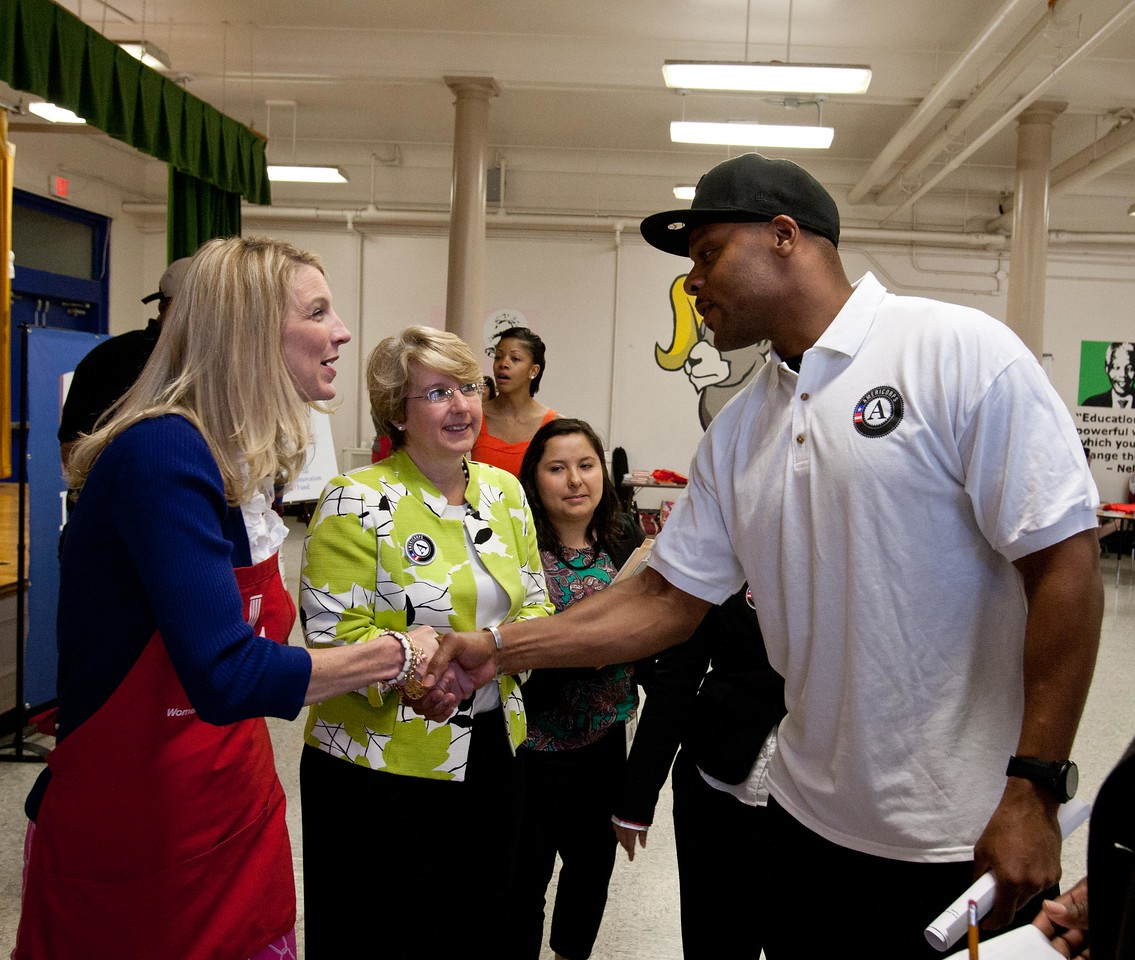 JLW President Wendy Cumberland meeting National Football League player Visanthe Shiancoe