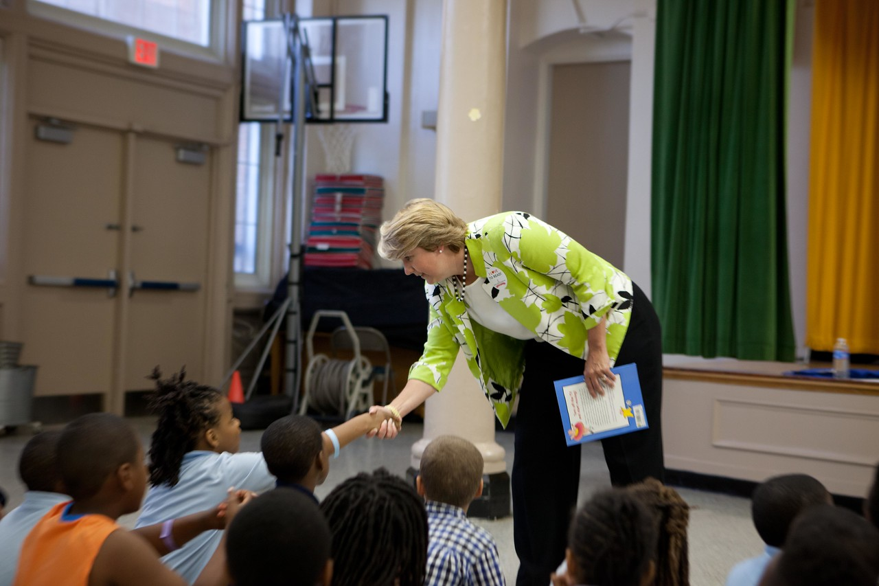 CNCS, CEO Wendy Spencer greets a student for Let's Read. Let's Move. Corporation for National and Community Service Photo.