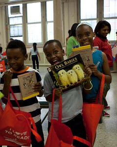 Grafield Eelementary students show off new books from Let's Read. Let's Move. Corporation for National and Community Service Photo.