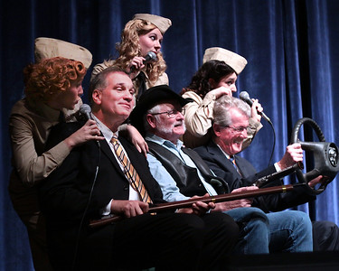 "America's Hometown Thanksgiving Celebration Executive Director, Olly deMacedo, audience member ""Cowboy"" Kevin M. Sullivan and Selectman Ken Tavares, enjoy their roles on stage with the Andrew Sisters Tribute singers at the Patriotic Concert."