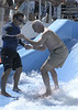 "Sir Ron tries the Flowrider:  ""OK, I think I can do this. Show all these kids what the old guys can do."""