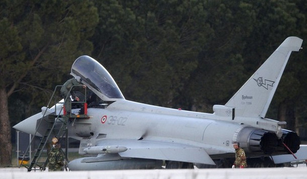 Ground crew and pilots prepare an Italian Eurofighter EF-2000 Typhoon at the Gioia del Colle NATO Airbase in the southern Italy on March 19, 2011.  Military action authorised by the United Nations against Libyan forces loyal to Muammar Gaddafi could take place under NATO command or under a coalition of the willing led by France and Britain. NATO said its ambassadors would meet to discuss their response, while analysts expect an initial strike would target Libya's military aircraft, air force bases and communication systems.  REUTERS/Giampiero Sposito ( ITALY - Tags: POLITICS MILITARY TRANSPORT)