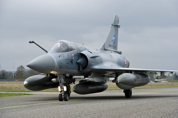 A French Mirage 2000-5 aircraft, seen in this photo released by ECPAD (French Defence communication and audiovisual production agency), prepares to take off from the Dijon military base on a mission to overfly Libya March 19, 2011. Western air forces, with Arab League approval, went into action in Libya on Saturday to curb attcks by Muammar Gaddafi's forces on the revel stronghold of Benghazi, French President Nicolas Sarkozy said.   REUTERS/ECPAD/SIRPA AIR/Anthony Jeuland (FRANCE  - Tags: MILITARY POLITICS) THIS IMAGE HAS BEEN SUPPLIED BY A THIRD PARTY. IT IS DISTRIBUTED, EXACTLY AS RECEIVED BY REUTERS, AS A SERVICE TO CLIENTS FOR EDITORIAL USE ONLY. NOT FOR SALE FOR MARKETING OR ADVERTISING CAMPAIGNS