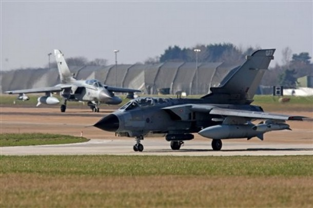 "An RAF Tornado taxis on the runway at RAF Marham, south east England Saturday March 19, 2011. British Prime Minister David Cameron ordered RAF Typhoon and Tornado fighter jets to deploy to the Mediterranean to help impose a no-fly zone in Libya authorized by United Nations Security Council resolution 1973, which said ""all necessary measures"" short of military occupation should be taken to protect civilians from forces loyal toMoammar Gadhafi.  (AP Photo/Chris Radburn/PA Wire)  UNITED KINGDOM OUT NO SALES NO ARCHIVE"