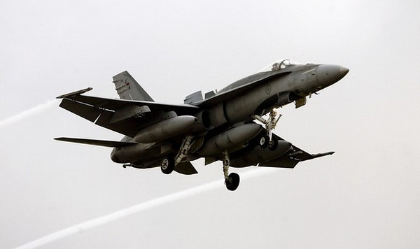 "An F18 Hornet of the Canadian air force prepares to land at the Trapani Birgi air base in the southern island of Sicily on March 18, 2011. Italy on March 18 offered the use of its air bases to impose a no-fly zone on Libya and said it could help take out Libyan radars and defence systems after the UN cleared the way for air strikes. Italy has ""granted the use of military bases on its national territory"", the government's press office said after an emergency cabinet meeting in Rome.     AFP PHOTO / MARCELLO PATERNOSTRO (Photo credit should read MARCELLO PATERNOSTRO/AFP/Getty Images)"