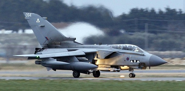 A British RAF Tornado lands at Gioia del Colle NATO Airbase in southern Italy March 21, 2011. Arab nations do not want the military intervention under way in Libya to be placed under NATO control, French Foreign Minister Alain Juppe said on Monday.   REUTERS/Giampiero Sposito ( ITALY  - Tags: POLITICS MILITARY CONFLICT)