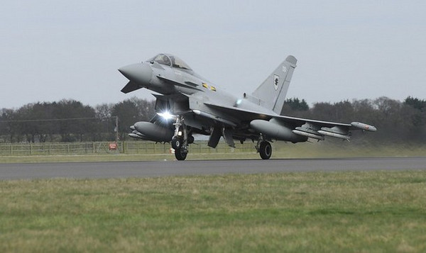 A Royal Air Force (RAF) Typhoon aircraft takes off from RAF Coningsby in eastern England, to take part in the UN resolution to enforce a no-fly zone in Libya, in this undated handout photograph received in London on March 21, 2011. Western powers launched a second wave of air strikes on Libya early on Monday after halting the advance of Muammar Gaddafi's forces on Benghazi and targeting air defences to let their planes patrol the skies.   REUTERS/Victoria Atkins/Crown Copyright/Handout     (BRITAIN - Tags: MILITARY POLITICS CONFLICT) NO COMMERCIAL OR BOOK SALES. NO SALES. NO ARCHIVES. FOR EDITORIAL USE ONLY. NOT FOR SALE FOR MARKETING OR ADVERTISING CAMPAIGNS. THIS IMAGE HAS BEEN SUPPLIED BY A THIRD PARTY. IT IS DISTRIBUTED, EXACTLY AS RECEIVED BY REUTERS, AS A SERVICE TO CLIENTS. NO THIRD PARTY SALES. NOT FOR USE BY REUTERS THIRD PARTY DISTRIBUTORS