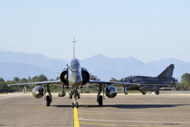 French Air Force Mirage jets, seen in this photo released March 20, 2011 by ECPAD (French Defence communication and audiovisual production agency), taxi on the runway upon their return from flight missions over Libya at the Solenzara military base in Corsica March 20, 2011.    REUTERS/ECPAD/HO  (FRANCE - Tags: MILITARY CONFLICT POLITICS) FOR EDITORIAL USE ONLY. NOT FOR SALE FOR MARKETING OR ADVERTISING CAMPAIGNS. THIS IMAGE HAS BEEN SUPPLIED BY A THIRD PARTY. IT IS DISTRIBUTED, EXACTLY AS RECEIVED BY REUTERS, AS A SERVICE TO CLIENTS