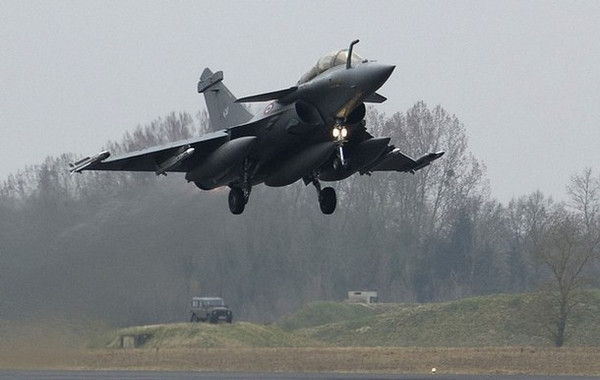 A French Dassault Rafale combat aircraft, seen in this photo released by ECPAD (French Defence communication and audiovisual production agency), takes off from Saint-Dizier military base, eastern France, March 19, 2011, on a mission to overfly Libya. Western air forces, with Arab League approval, went into action in Libya on Saturday to curb attacks by Muammar Gaddafi's forces on the rebel stronghold of Benghazi, French President Nicolas Sarkozy said.     REUTERS/ECPAD/Sebastien Dupont  (FRANCE - Tags: POLITICS MILITARY TRANSPORT) FOR EDITORIAL USE ONLY. NOT FOR SALE FOR MARKETING OR ADVERTISING CAMPAIGNS