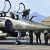 French Air Force pilots and ground crew, seen in this photo released March 20, 2011 by ECPAD (French Defence communication and audiovisual production agency), work near their Mirage jets upon their return from flight missions over Libya at the Solenzara military base in Corsica March 20, 2011.    REUTERS/ECPAD/HO  (FRANCE - Tags: MILITARY CONFLICT POLITICS) FOR EDITORIAL USE ONLY. NOT FOR SALE FOR MARKETING OR ADVERTISING CAMPAIGNS. THIS IMAGE HAS BEEN SUPPLIED BY A THIRD PARTY. IT IS DISTRIBUTED, EXACTLY AS RECEIVED BY REUTERS, AS A SERVICE TO CLIENTS
